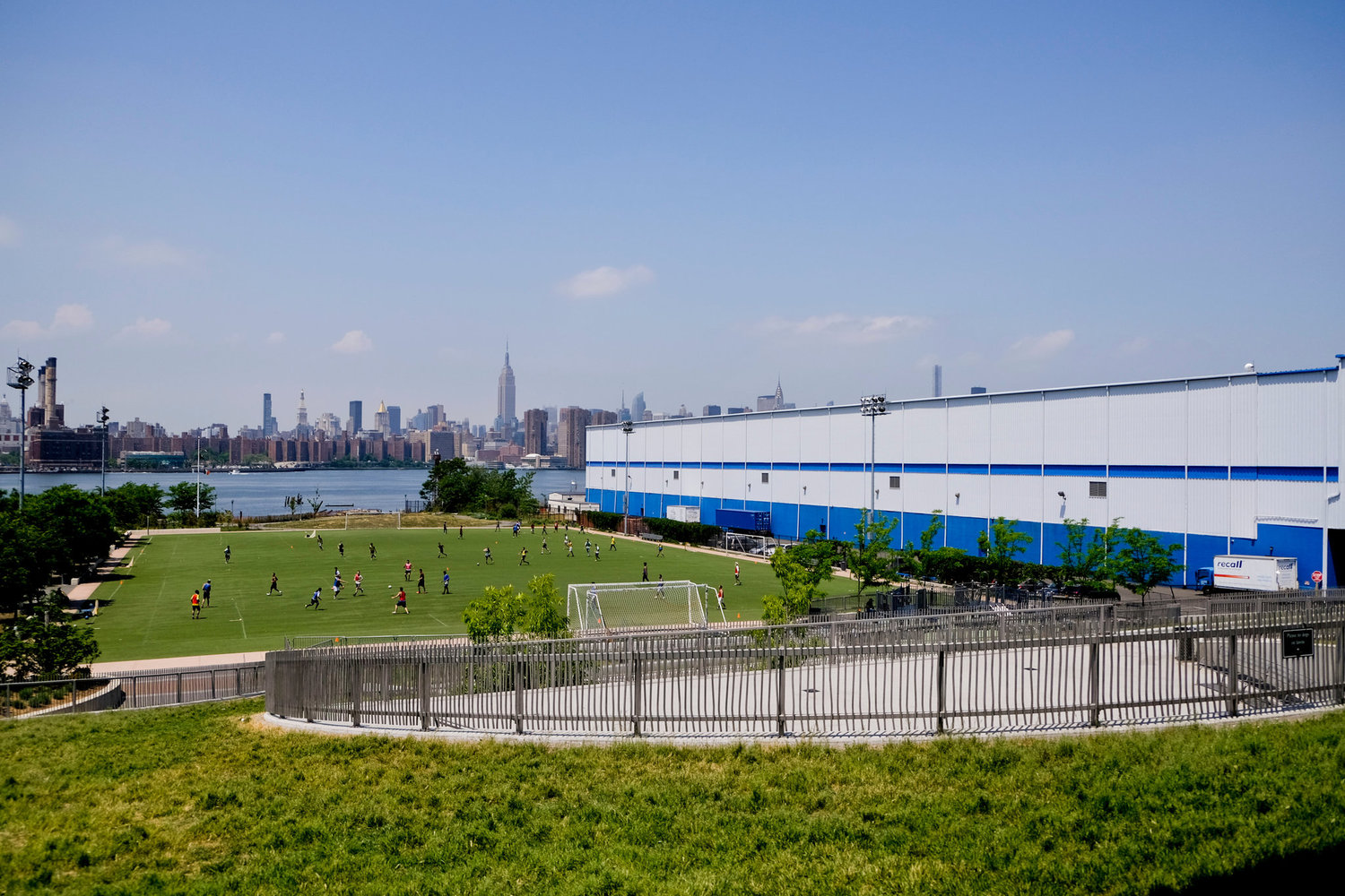Abutting the waterfront in Williamsburg, the Bushwick Inlet Park consists of a five-acre playing field on what used to be a lot for rental trucks.