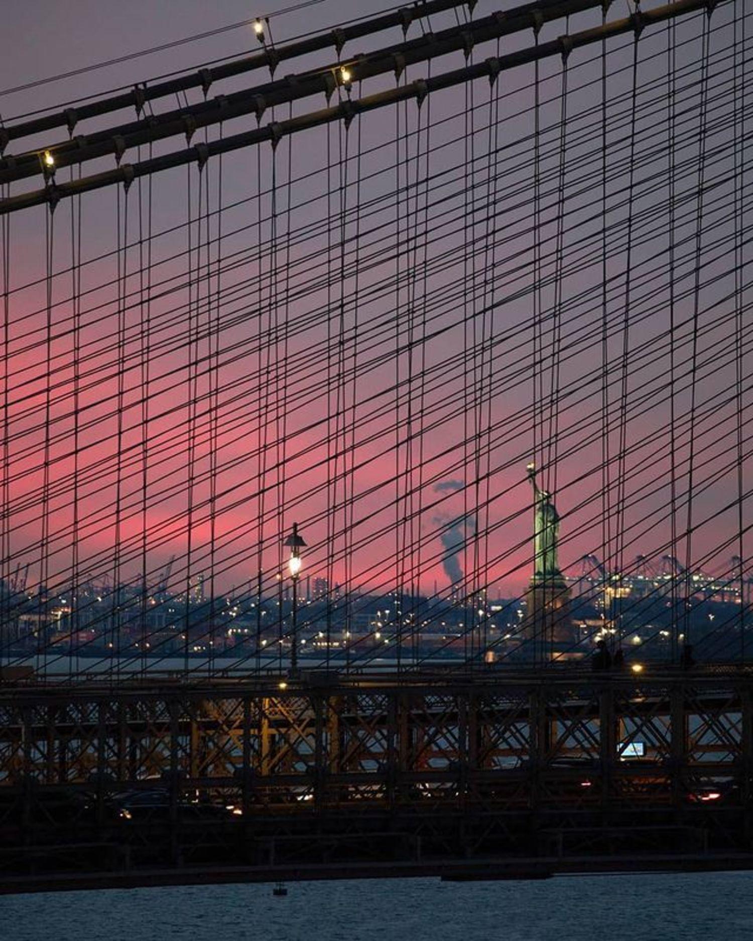 Sunset through the Brooklyn Bridge Cables, New York