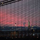 Sunset through the Brooklyn Bridge Cables, New York