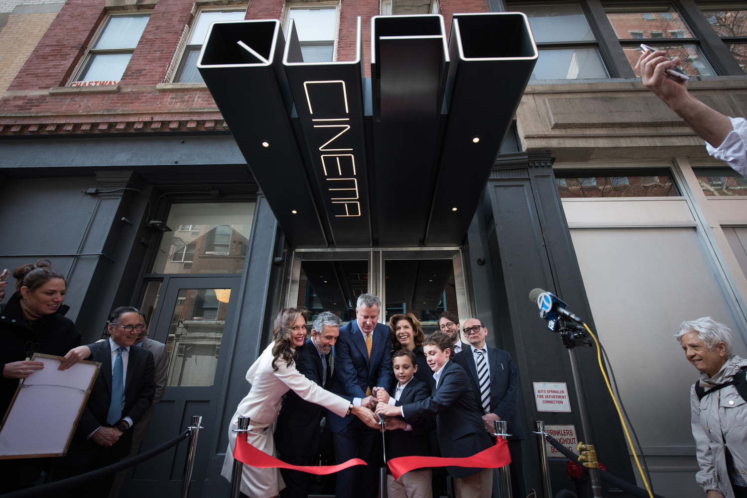 Mayor Bill de Blasio and MOME Commissioner Julie Menin attend a ribbon-cutting ceremony for the relaunch of the Quad Cinema in Greenwich Village on Thursday, April 13, 2017.