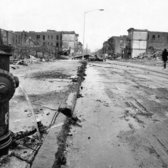 "Dec. 18, 1969: A neglected block in Brownsville, Brooklyn, where a nationwide Model Cities program — which aimed to bring a holistic improvement regimen to selected neighborhoods in 52 cities — was seen as stumbling. ""Half of the program's first year is gone,"" The Times reported, ""but only $7.7 million of the year's allocation of $29 million in Federal funds have been spent."" The mayor blamed a heavy-footed city bureaucracy. ""The mood is typified by Prospect Place in Brownsville, flanked by desolate acres of rubble-strewn lots,"" the story read. ""Rotted tenements have been torn down, but almost nothing is being built because contractors' bids have come in above the per-room cost ceilings permitted by Congress for Federal projects."""