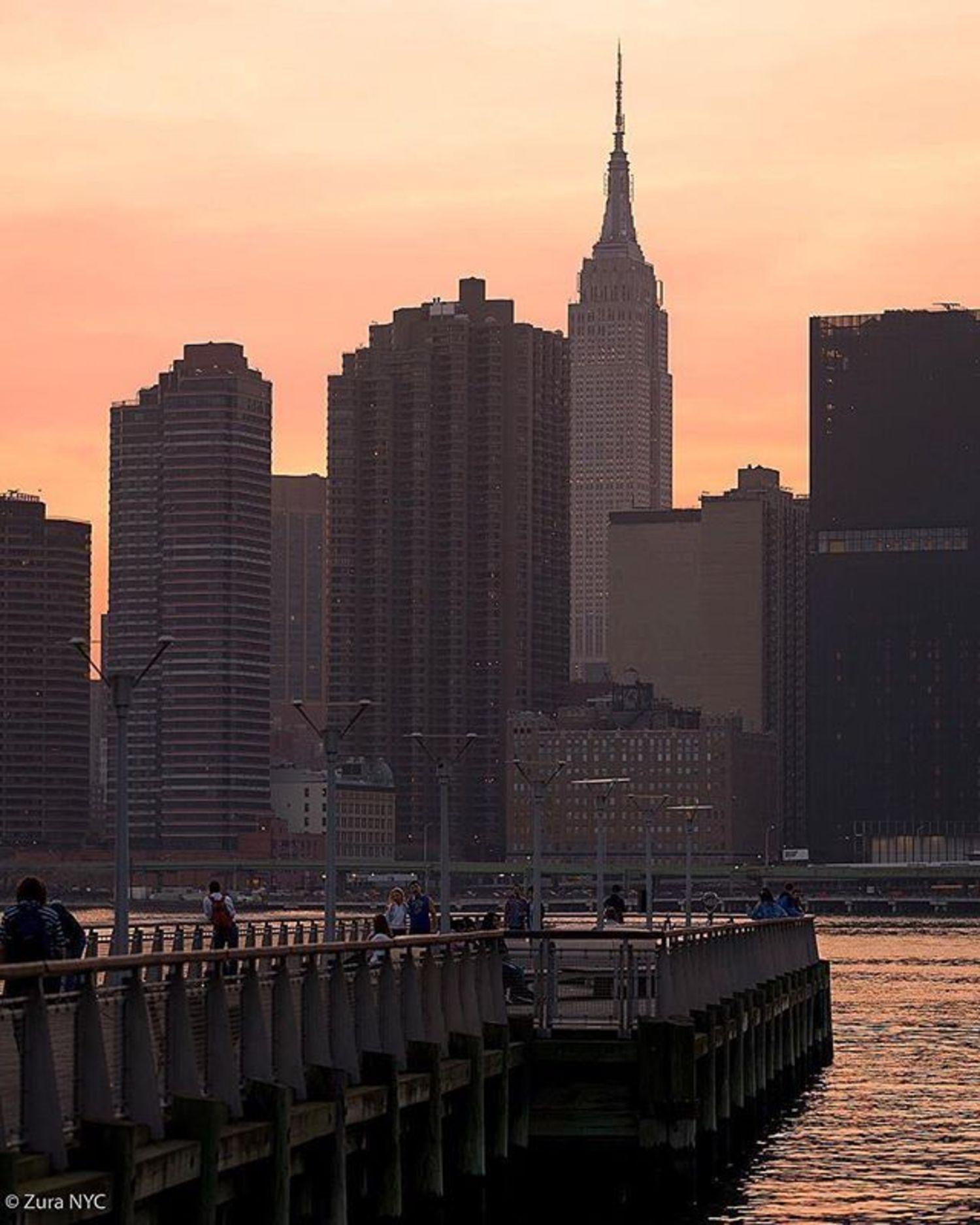 New York, New York. Photo via @zura.nyc #viewingnyc #newyork #newyorkcity #sunset #empirestatebuilding