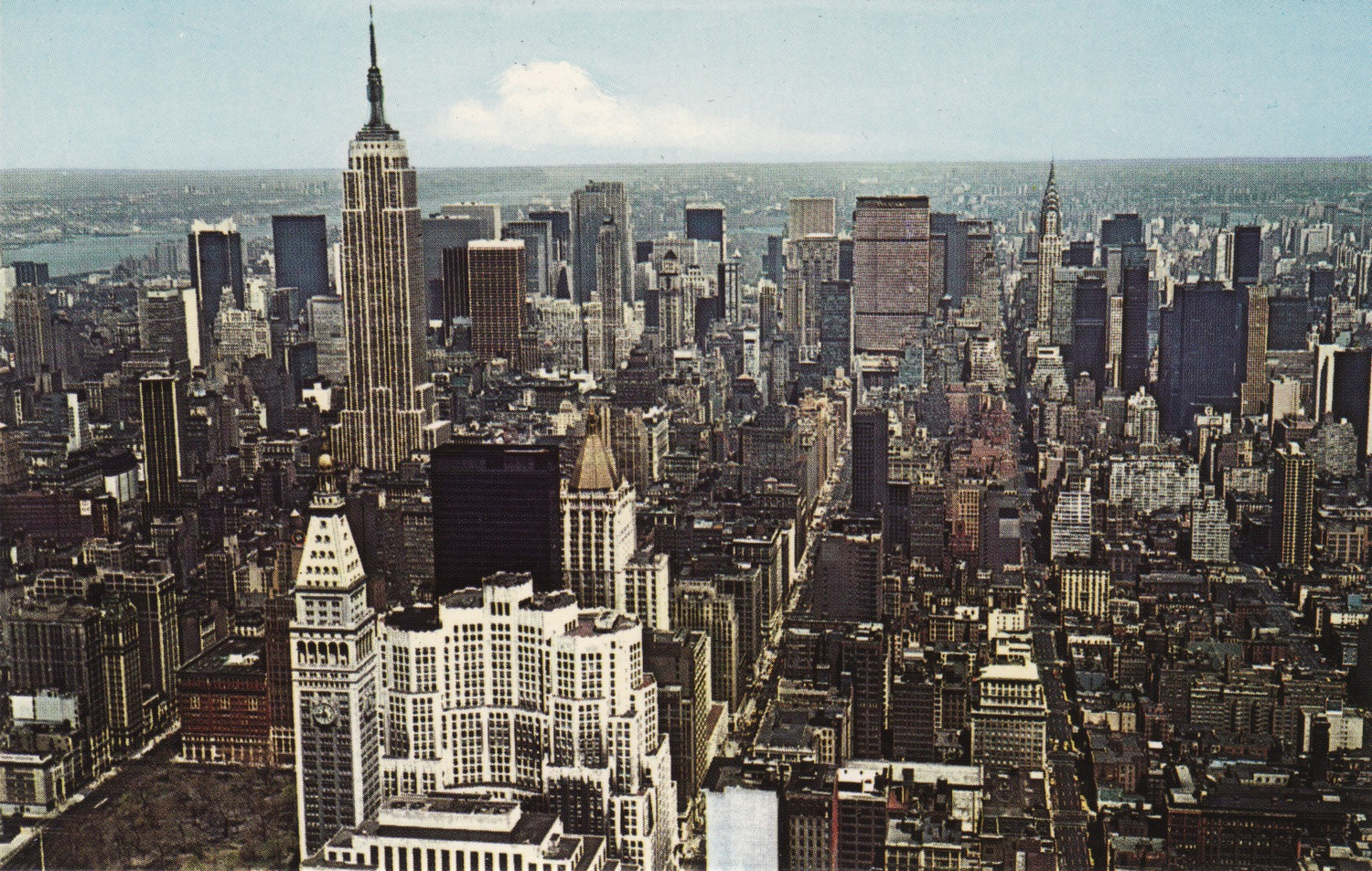 Turning the view north, the white skyscrapers in the foreground are the Metropolitan Life Building and New York Life Insurance Buildings.