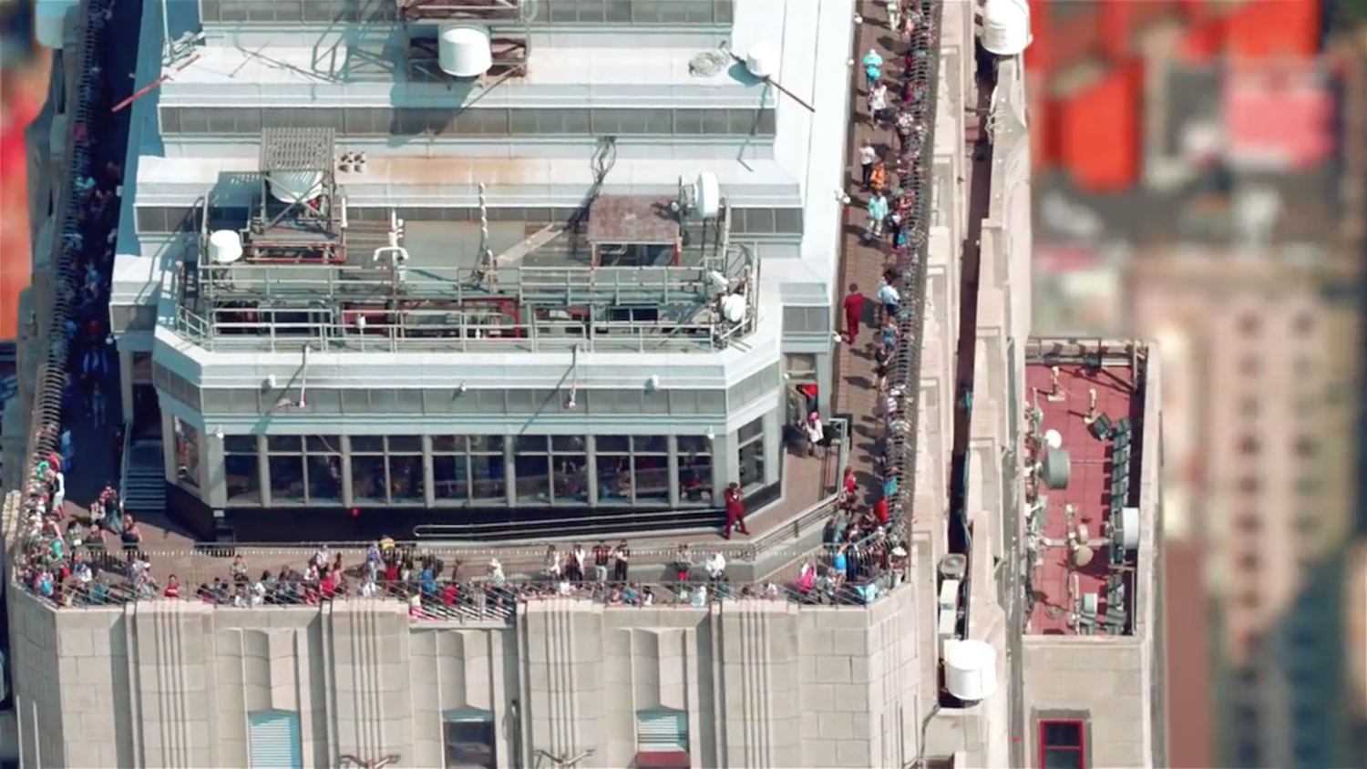 The camera captures a rare view of the Empire State Building's 86th floor observation deck from above. As a testament to its popularity, more money is generated from the observatory than the renting of office space in the building.