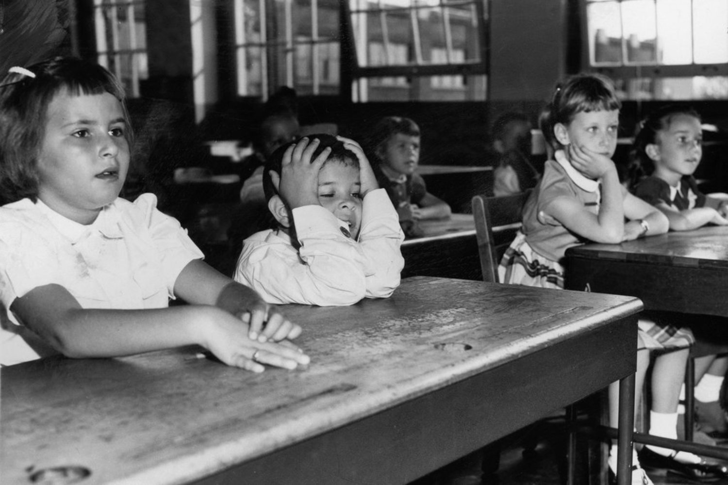 1950s - September 1957: The first day elicits varied reactions from first graders.