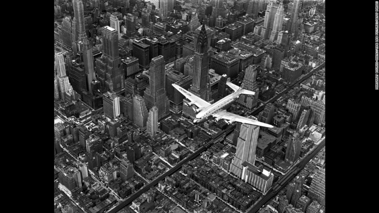 Life magazine photographer Margaret Bourke-White snapped this photo showing a DC-4 passenger plane flying over midtown Manhattan in 1939.
