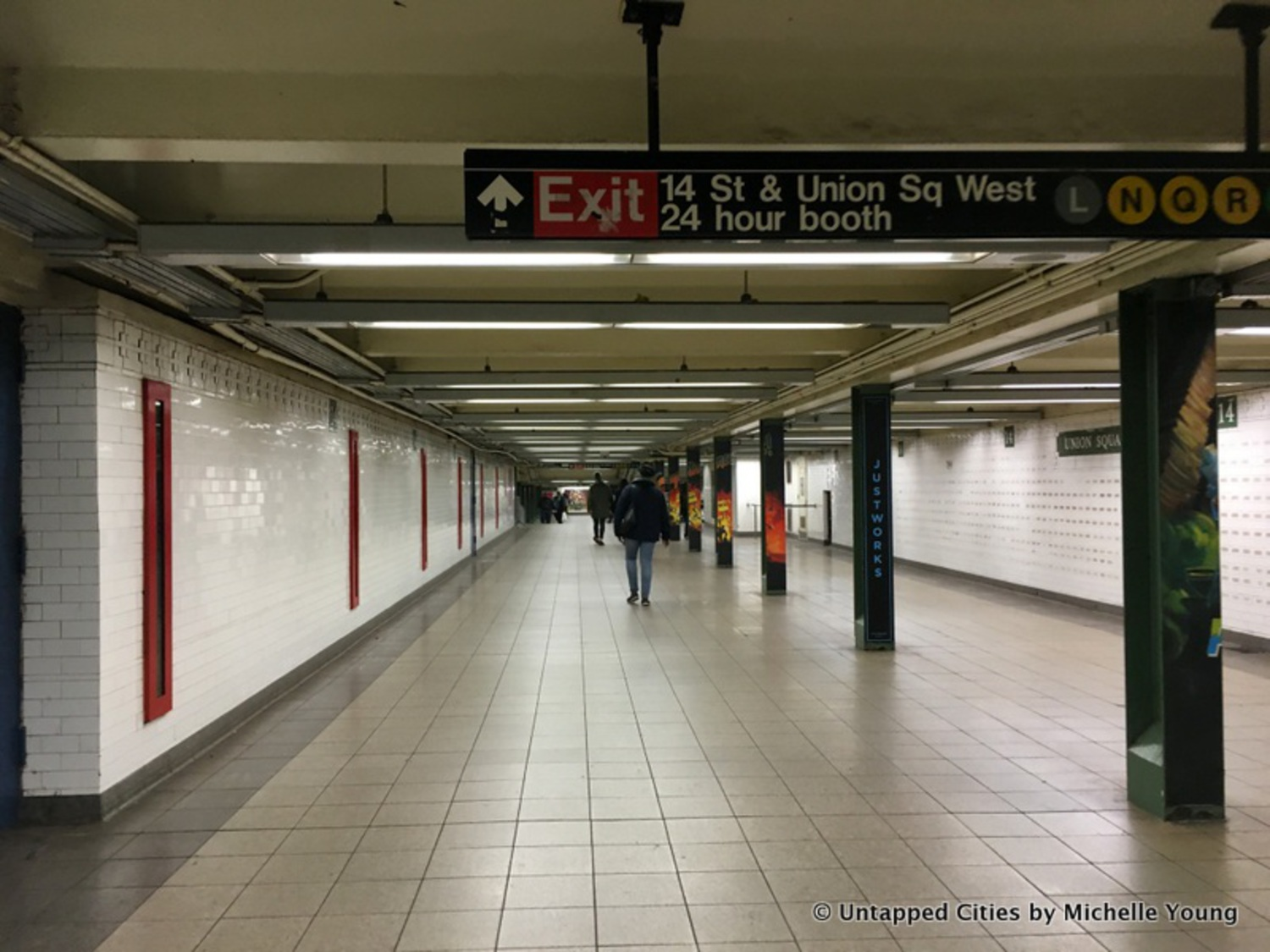 Along one corridor between the 14th Street and 17th Street entrances are narrow openings, with printed fragments of the station's history, like telephone cables and names of former transit workers.