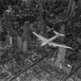 DC-4 flying over New York City, 1939