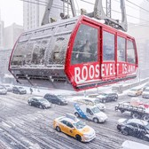 Freezing commute. The Roosevelt Island Tram above Second Avenue during the snowstorm this morning. Roosevelt Island Tramway in Manhattan, New York City