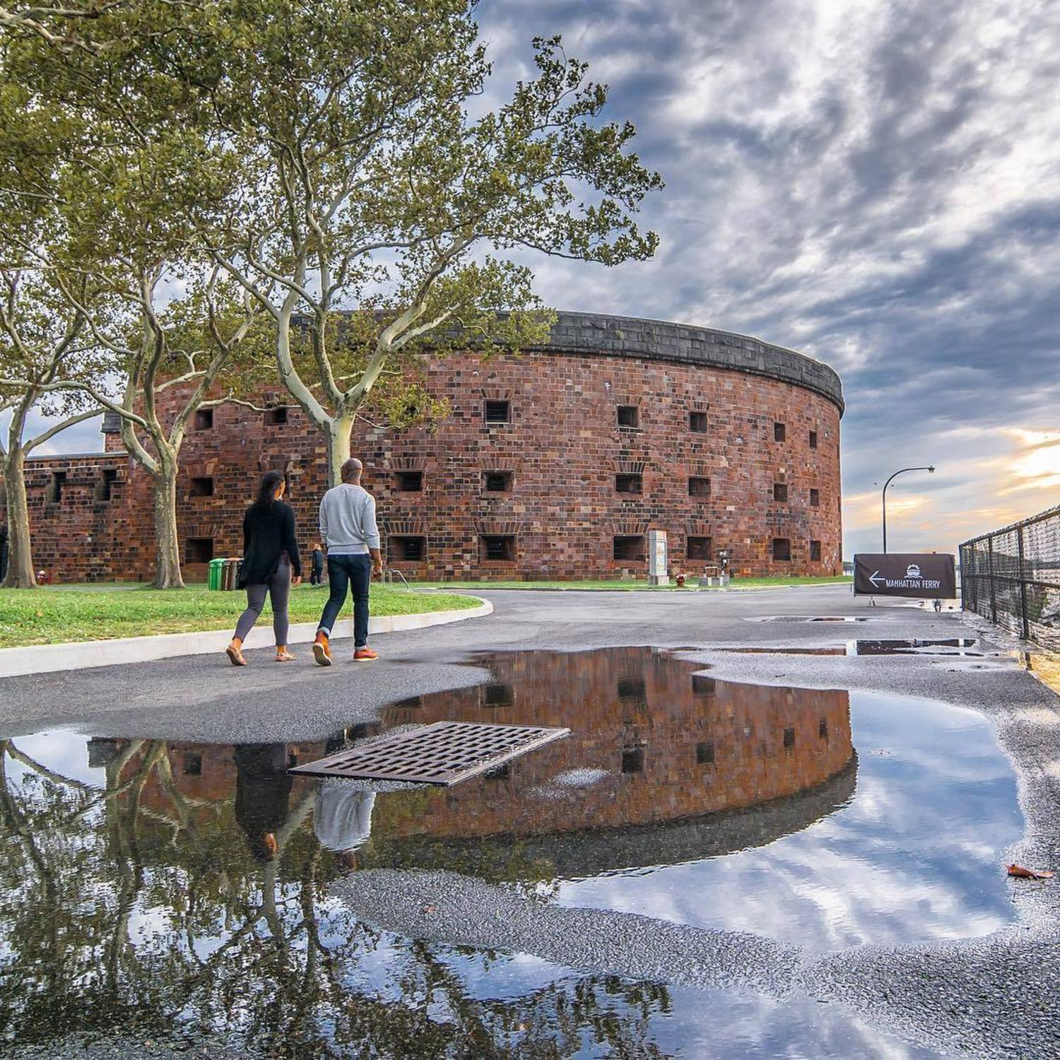 Castle Williams, a circular fortification of red sandstone on Governors Island. It is one of several forts built in the early 19th century to protect New York City from naval attack. Governors Island, New York City
