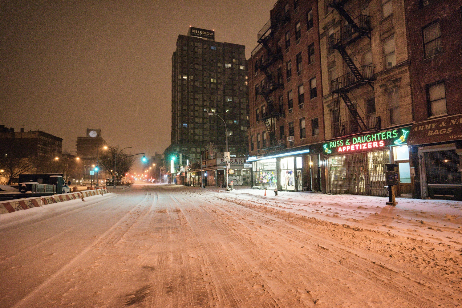 "New York City - Snow - Winter Storm Juno - Empty Houston Street | Juno: The first snowstorm of 2015 in New York City.  ---  (Note: My <a href=""http://www.amazon.com/gp/product/1440339589/ref=as_li_tl?ie=UTF8&camp=1789&creative=9325&creativeASIN=1440339589&linkCode=as2&tag=nyththle0e-20&linkId=ER6GYT5FRYNMEPLF"" rel=""nofollow"">New York photography book</a> released worldwide in stores/online recently and has photos similar to this  [full info below])  ---  I have been photographing New York City during snowstorms at night for the past 5 years. When it comes to experiencing <a href=""http://nythroughthelens.com/tagged/snow"" rel=""nofollow"">New York City in the snow</a>, I relish the challenge. The more gusty, snowy, and brutal the storm, the more of a chance that I will be out in it traipsing around New York City with my cameras in tow.  When I heard that the MTA was suspending all transit service (and most vehicles) at 11 pm, I made the decision to take the train up to the Upper East Side prior to 11 pm to deposit myself up there with the intention of walking from the Upper East Side to Times Square and then walking the several miles back to the Lower East Side (whew!!).  The streets were eerily empty.  Emptier than they are usually at night during snowfall. Since there was a ban on all vehicles aside from snow plows and emergency services, there were practically no cars at all on the streets. Even taxis were banned from the streets!  I walked in the middle of avenues and streets that are usually teeming with cars.  There was an eerie sense of calm.  It was magical.   ---  This is part of a post that I posted to my NYC photography blog. If you are curious enough to look at the photos there, here is the link to the post:  <a href=""http://nythroughthelens.com/post/109291619025/new-york-city-snow-winter-storm-juno-i"" rel=""nofollow"">New York City - Winter Storm Juno</a>   ----  * As mentioned above - My New York City coffee table book that released in stores/online worldwide recently.   Tons of information about my <a href=""http://www.amazon.com/gp/product/1440339589/ref=as_li_tl?ie=UTF8&camp=1789&creative=9325&creativeASIN=1440339589&linkCode=as2&tag=nyththle0e-20&linkId=ER6GYT5FRYNMEPLF"" rel=""nofollow"">New York photography book</a> with sample pages (including where to order and what stores are carrying it) here:  <a href=""http://nythroughthelens.com/post/92873566010/ny-through-the-lens-the-book-i-am-super"" rel=""nofollow"">NY Through The Lens: A New York Coffee Table Book</a> ---   View my New York City photography at my website <a href=""http://nythroughthelens.com/"" rel=""nofollow"">NY Through The Lens</a>.  View my Travel photography at my travel blog: <a href=""http://travelinglens.me/"" rel=""nofollow"">Traveling Lens</a>.  Interested in my work and have questions about PR and media? Check out my:  <a href=""http://nythroughthelens.com/about"" rel=""nofollow"">About Page</a> 