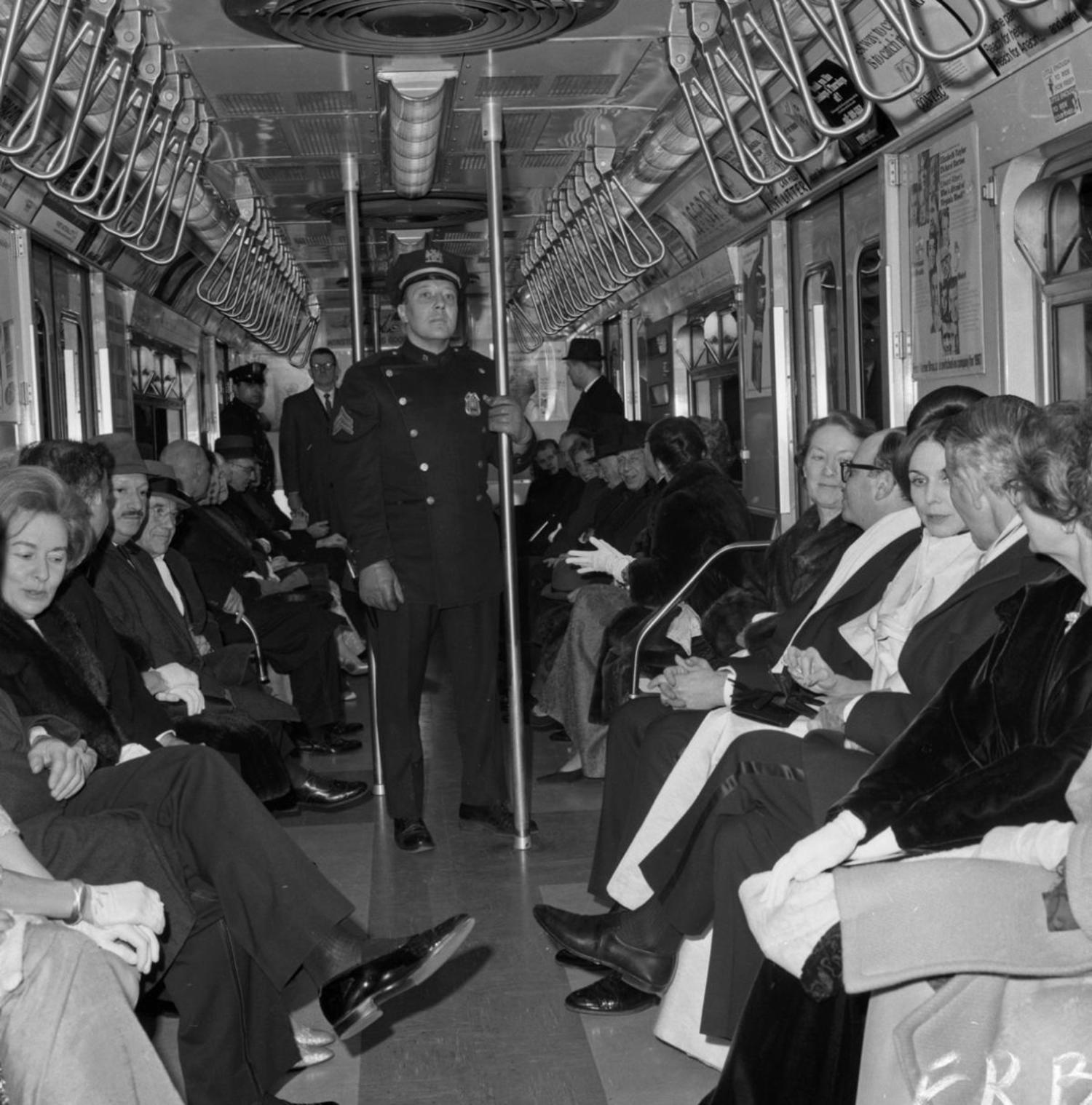 1960's: It's a scene straphangers today might not recognize. While passengers sit aboard a subway train, Transit Authority Sgt. Len Cancelleri patrols the crowded car to ensure that no one aboard gets mugged.