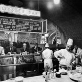 "July 31, 1974: When the Oyster Bar and Restaurant at Grand Central Terminal closed with little warning, diners and employees alike were dismayed. ""When I want oysters on the half-shell and nothing more, where do I go?"" asked one customer. However, it was expected to reopen soon (and did, with new management), and was reviewed favorably in The Times later that year (though the mussels, at $2.25, were deemed overpriced)."""