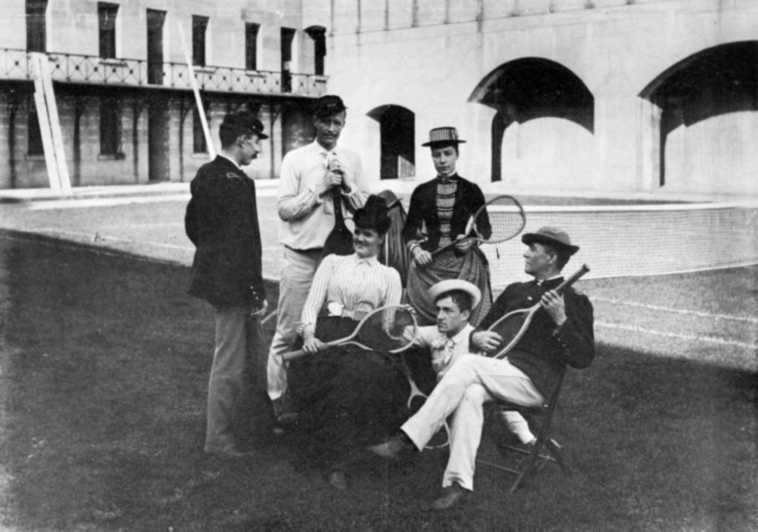 Photograph of Alice Austen's leisurely tennis game at Fort Wadsworth. Austen is standing third from the left.