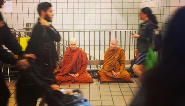 Meditating in a New York subway station.
