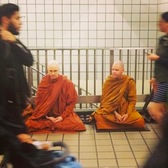Meditating in a New York subway station.
