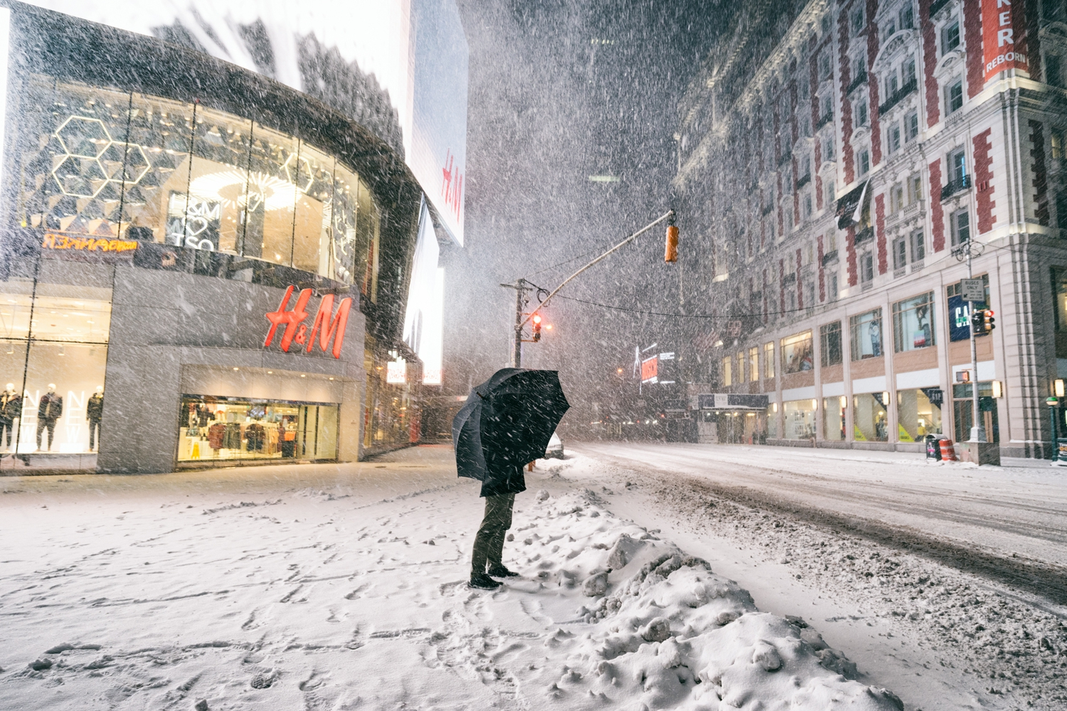 "New York City - Snow - Winter Storm Juno - Times Square | Juno: The first snowstorm of 2015 in New York City.  ---  (Note: My <a href=""http://www.amazon.com/gp/product/1440339589/ref=as_li_tl?ie=UTF8&camp=1789&creative=9325&creativeASIN=1440339589&linkCode=as2&tag=nyththle0e-20&linkId=ER6GYT5FRYNMEPLF"" rel=""nofollow"">New York photography book</a> released worldwide in stores/online recently and has photos similar to this  [full info below])  ---  I have been photographing New York City during snowstorms at night for the past 5 years. When it comes to experiencing <a href=""http://nythroughthelens.com/tagged/snow"" rel=""nofollow"">New York City in the snow</a>, I relish the challenge. The more gusty, snowy, and brutal the storm, the more of a chance that I will be out in it traipsing around New York City with my cameras in tow.  When I heard that the MTA was suspending all transit service (and most vehicles) at 11 pm, I made the decision to take the train up to the Upper East Side prior to 11 pm to deposit myself up there with the intention of walking from the Upper East Side to Times Square and then walking the several miles back to the Lower East Side (whew!!).  The streets were eerily empty.  Emptier than they are usually at night during snowfall. Since there was a ban on all vehicles aside from snow plows and emergency services, there were practically no cars at all on the streets. Even taxis were banned from the streets!  I walked in the middle of avenues and streets that are usually teeming with cars.  There was an eerie sense of calm.  It was magical.   ---  This is part of a post that I posted to my NYC photography blog. If you are curious enough to look at the photos there, here is the link to the post:  <a href=""http://nythroughthelens.com/post/109291619025/new-york-city-snow-winter-storm-juno-i"" rel=""nofollow"">New York City - Winter Storm Juno</a>   ----  * As mentioned above - My New York City coffee table book that released in stores/online worldwide recently.   Tons of information about my <a href=""http://www.amazon.com/gp/product/1440339589/ref=as_li_tl?ie=UTF8&camp=1789&creative=9325&creativeASIN=1440339589&linkCode=as2&tag=nyththle0e-20&linkId=ER6GYT5FRYNMEPLF"" rel=""nofollow"">New York photography book</a> with sample pages (including where to order and what stores are carrying it) here:  <a href=""http://nythroughthelens.com/post/92873566010/ny-through-the-lens-the-book-i-am-super"" rel=""nofollow"">NY Through The Lens: A New York Coffee Table Book</a> ---   View my New York City photography at my website <a href=""http://nythroughthelens.com/"" rel=""nofollow"">NY Through The Lens</a>.  View my Travel photography at my travel blog: <a href=""http://travelinglens.me/"" rel=""nofollow"">Traveling Lens</a>.  Interested in my work and have questions about PR and media? Check out my:  <a href=""http://nythroughthelens.com/about"" rel=""nofollow"">About Page</a> 