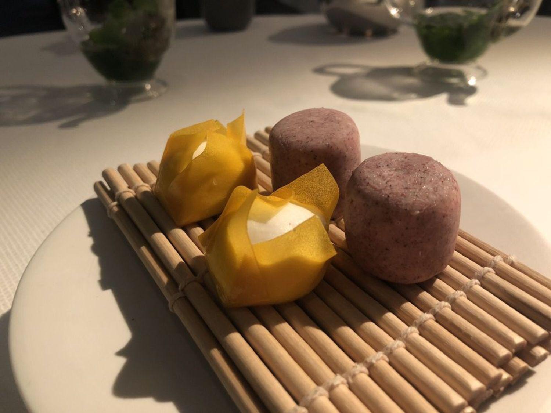 Dessert amuse-bouche. Coconut and mango shumai, blueberry and jasmine ice cream