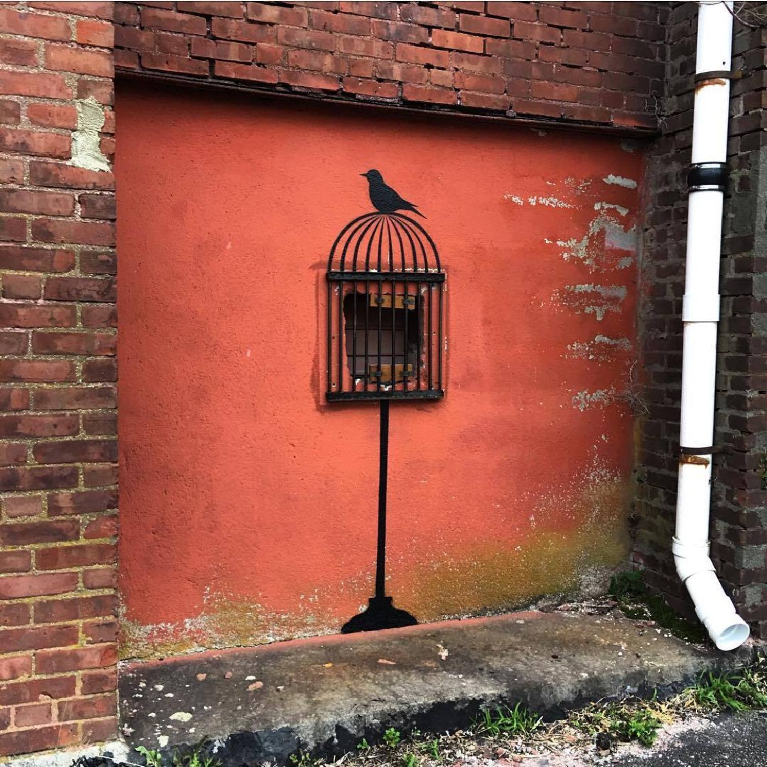 TAKE THESE BROKEN WINGS AND LEARN TO FLY... #blackbird #freedom #uncaged #newbedford #massachusetts #streetart #tombobnyc #stencil #publicart #nbma #🕊#❤️ #mayaangelou #tombob #stencilart #birdcage