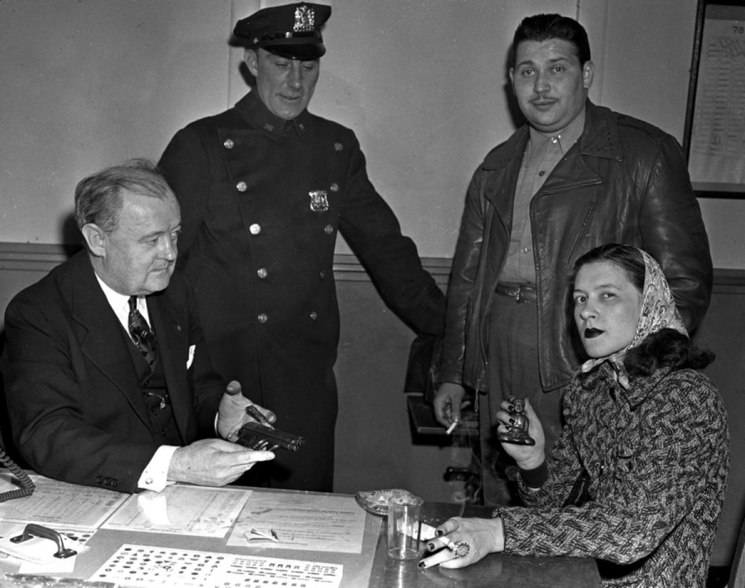 "Mob Moll, 1942: She pleads the fifth! Mob moll Smitty White was arrested and held at police headquarters in 1942 after her boyfriend Ralph Prisco was shot and killed by police during a failed holdup. Mob molls are also known as gun molls, or even gangster molls. The term moll is derived from the world ""Molly,"" a 17th century euphemism for either ""whore"" or ""prostitute."""