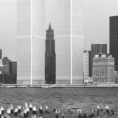The Woolworth Building framed by the Twin Towers, 1973