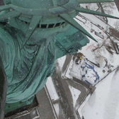 Looking Down on the Statue of Liberty as She Enjoys the Snow Day