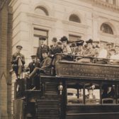 Group portrait of passengers on an observation automobile.