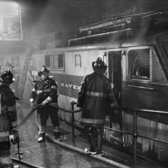 "March 28, 1967: Firemen at the scene a fire on a track at Grand Central Terminal, where a fire on a train of the New Haven line sent smoke billowing through the station and into the Pan Am building and prompting evacuations. ""The smoke was pouring out, and people kept demanding to know when their rains were leaving,"" one witness reported to The Times."