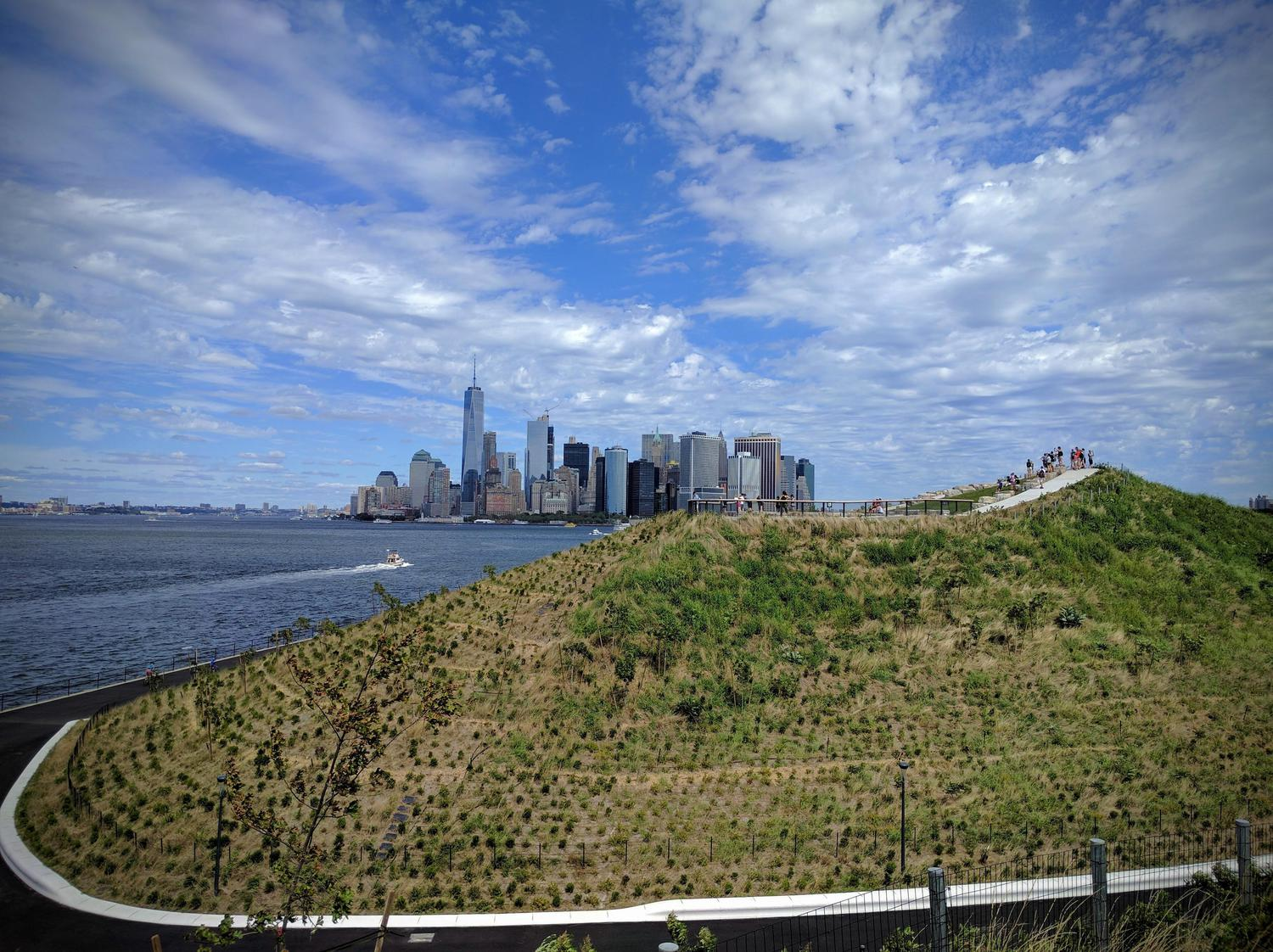 A majestic view of Downtown Manhattan and One World Trade from The Hills on Governors island on Sept 11, 2016