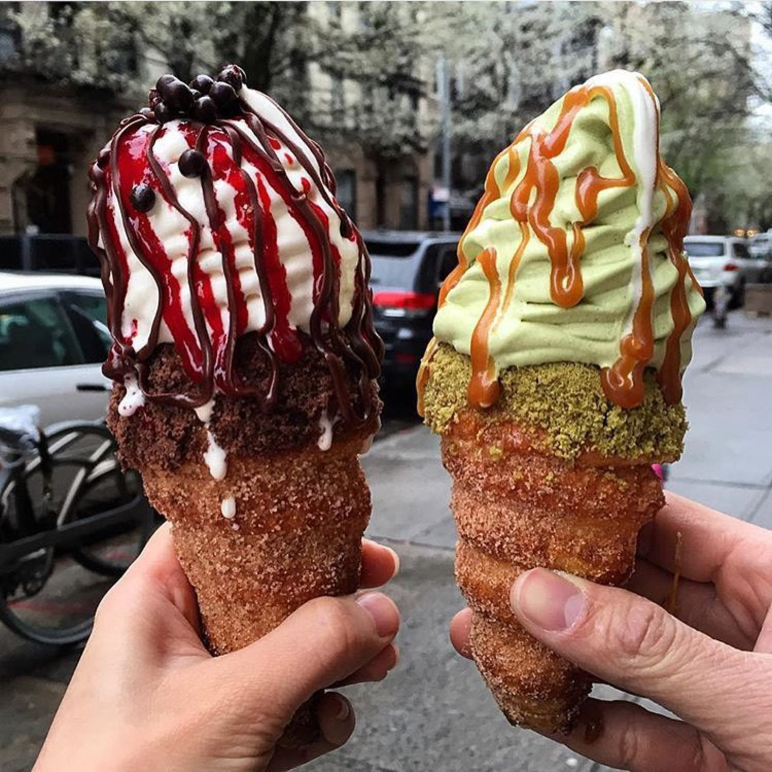 "coneCHURRO!® NYC! 1:30pm - midnight, daily.  Lookout for additional MAY FLAVORS!! *Banana Brûlée *Strawberry Shortcake, *Nutella S'mores Galore!!! Pictured: choco raspberry, green tea sea salt caramel. Photo cred: feedyourgirlfriend. JHERI CURL - sea salt caramel coated inner cone, cinnamon struessel rim with sea salt caramel drizzle.  NUTTY PROFESSOR:  nutella smeared ""inner"" cone with brown sugar pecan rim, world's tastiest tahitian vanilla bean soft serve with toasted almonds, nutella drizzle and frosted pecan top.  TWINKLE SPRINKLES:  66% Valrhona caribe chocolate ganache coated inner cone with happy dance rainbow sprinkles.  POINDEXTER:  66% Valrhona caribe chocolate ganache coated inner cone with happy dance rainbow sprinkled RIM.  CHOCO-RASPBERRY SUNDAE:  chocolate ganache/raspberry jam filling, chocolate struessel rim, raspberry and chocolate sauce drizzle.  GREEN ENVY:  red bean inner cone, green tea struessel rim, green tea/vanilla swirl, red bean top.  204 E. 10th st. @2nd Ave., NYC, BITCHESSSZz.  conechurro.com"
