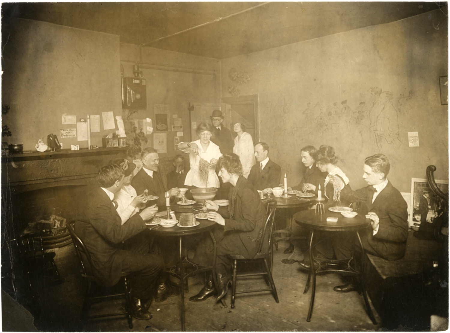 Spaghetti dinner in Grace Godwin's garret, 58 Washington Square South, 1917-1918; photograph by Jessie Tarbox Beals.