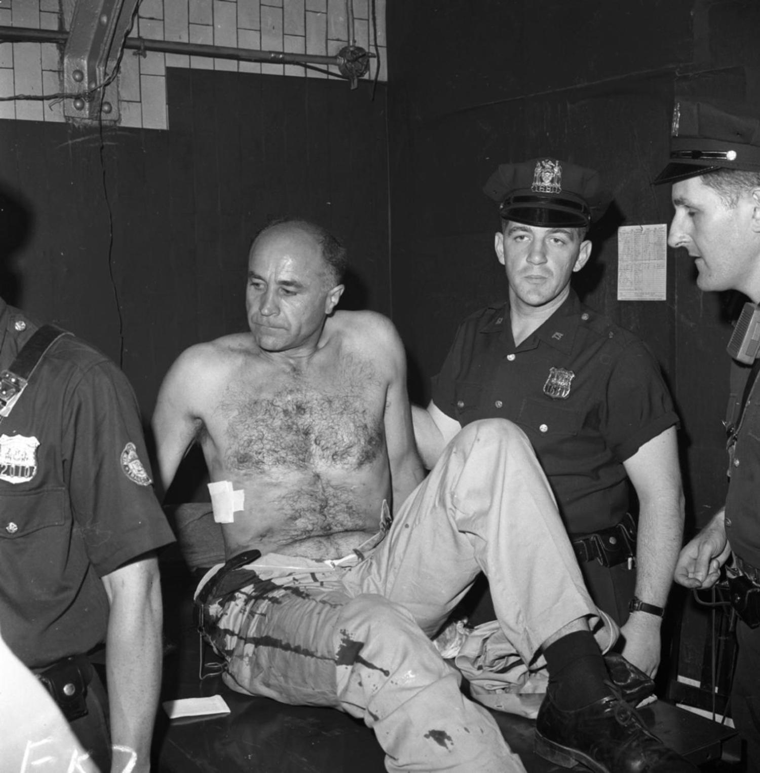 1960's: Navigating the underground tunnels constituting New York's subway system could be dangerous business. Here, a man is treated in Grand Central Station after being stabbed on the subway.