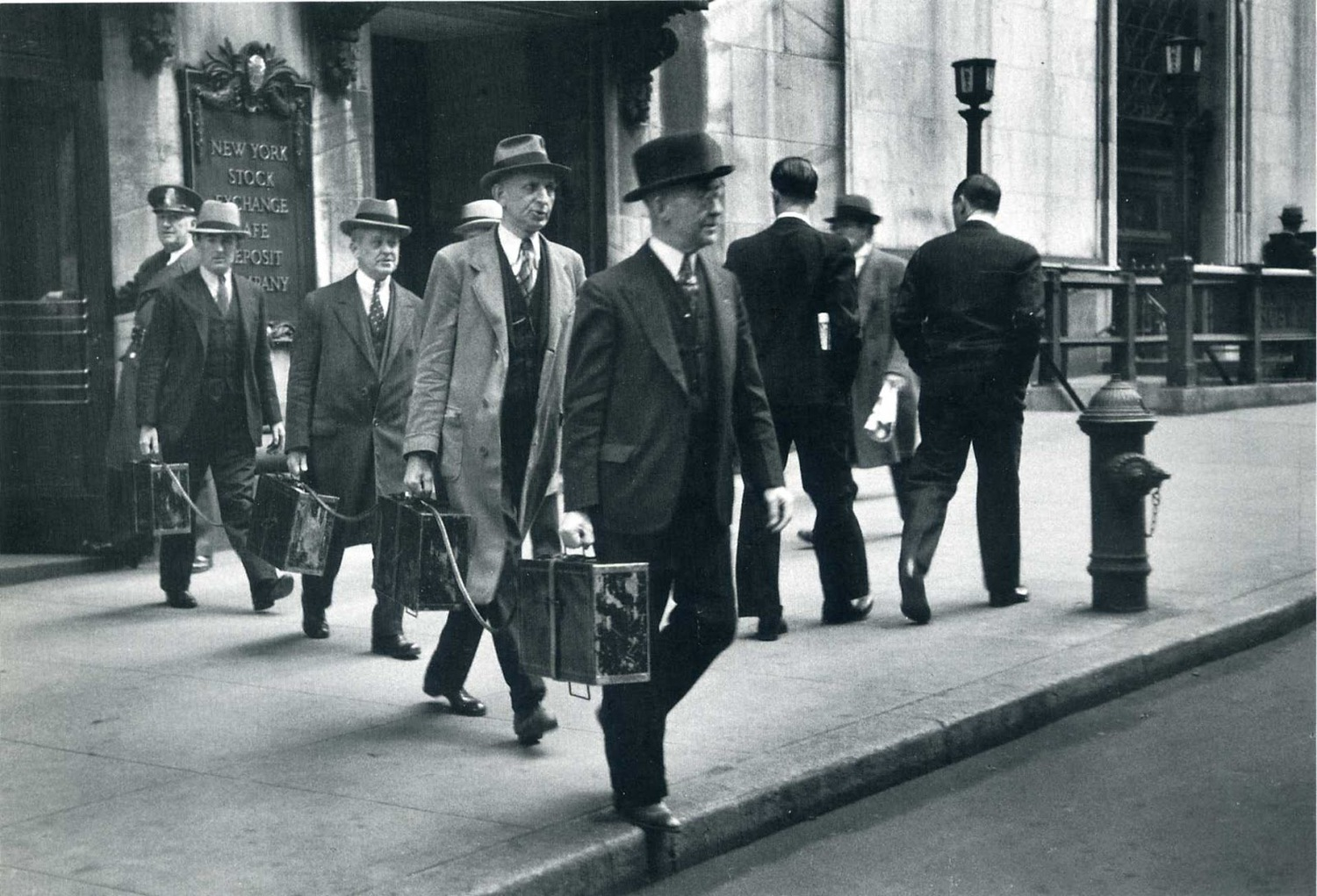 """Chain Gang"" of New York Stock Exchange Officers Carries Traded Securities Each Day to Banks and Brokerage Houses, New York, 1937 by Carl Mydans."