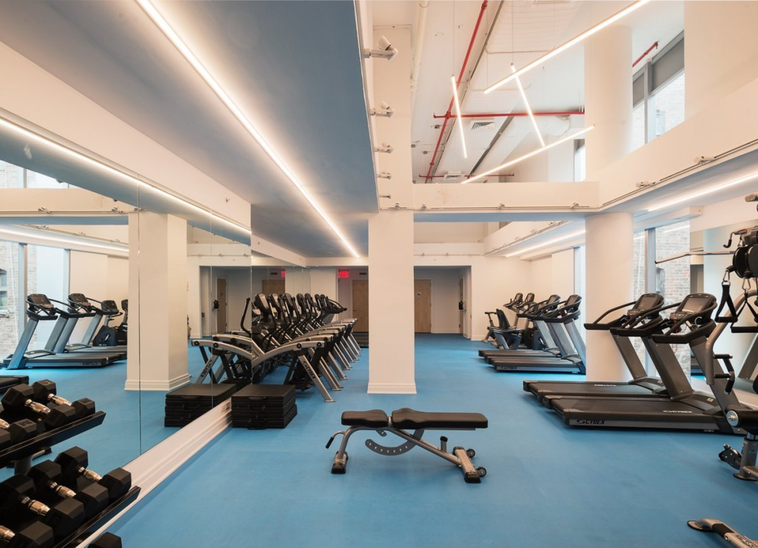 The building also counts a gym among its amenities. Use of both the gym and rooftop will cost residents about $600 a year.