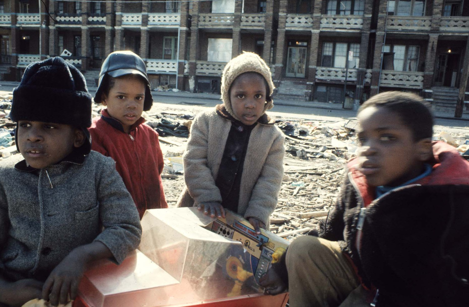 Children playing with a broken toy. Coney Island, Brooklyn, 1971.