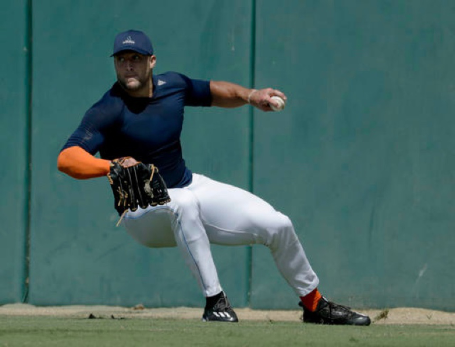 Tim Tebow, showing off his uh...athletic grace, during a showcase at USC last month.