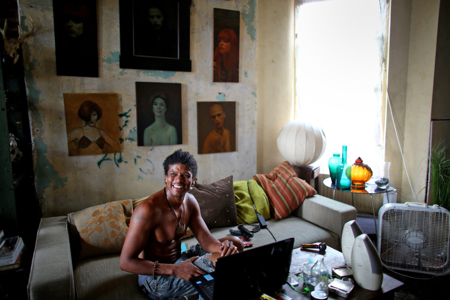 Jean Paul Chatham, originally from Belize, inside the apartment that he shares with Steven Ashmore, an original homesteader.