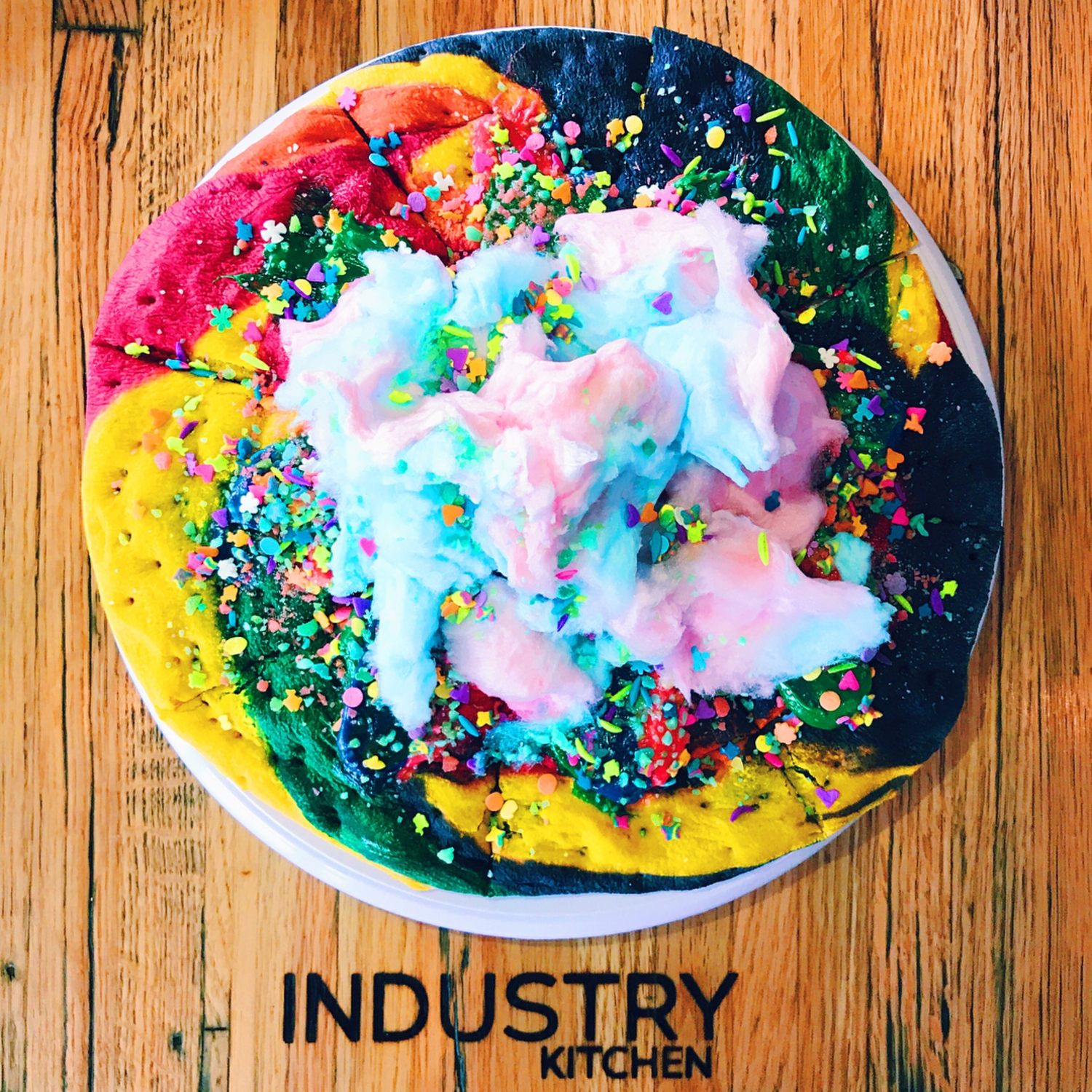 Unicorn pizza exists and it's basically a giant sugar cookie covered in fluffy cotton candy ✨🍕🦄 #cosmobites