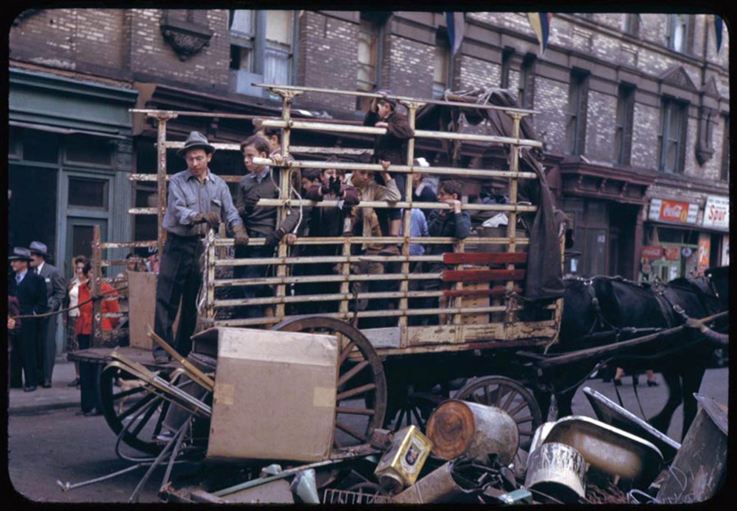 The men pictured here are collecting wartime salvage left outside on the streets of the Lower East Side.