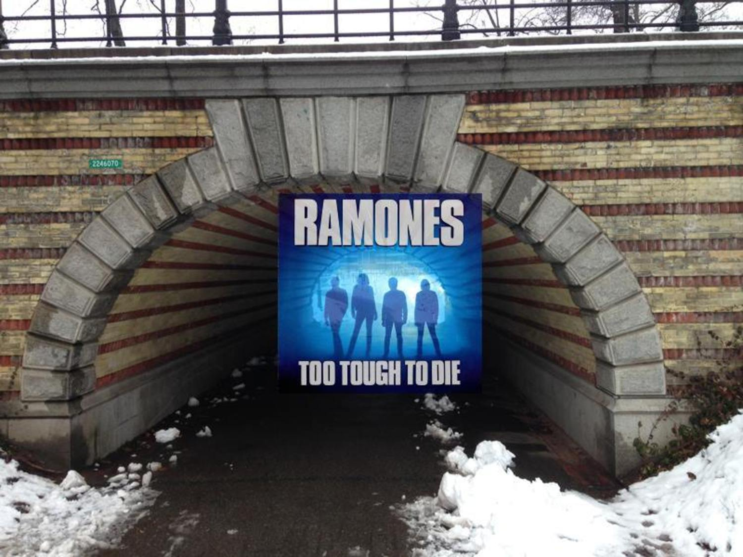 "TOO TOUGH TO DIE by THE RAMONES (1984, Sire). . .Photo by George DuBose. . .Location: underneath Playmates Arch, next to the Carousel in Manhattan's Central Park  (near where Center Drive meets the 65th St. Traverse). . .The album was the Ramones eighth studio album and the first to feature Richie Ramone on drums. . .According to Wikipedia: ""The photograph on the album cover, which features silhouettes of the band members, resulted from a ""lucky accident"" after photographer George DuBose's camera malfunctioned"" . . .Click the following link to be taken inside Playmates Arch tunnel, with its distinctive yellow-and-red brick stripes, via Google Street Views: http://bit.ly/2bIjvKE"