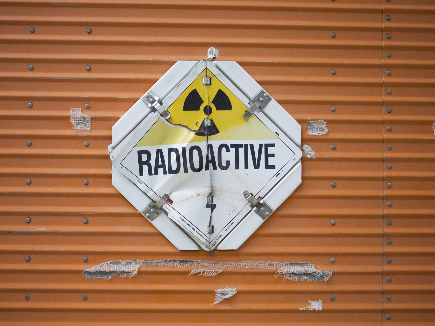 "(unrelated ""radioactive"" sign, not on site)"