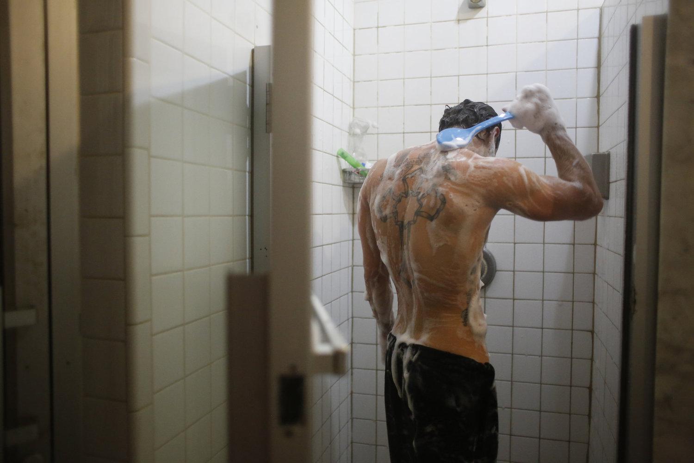Adik Sukiasyan scrubs down after using the sauna.