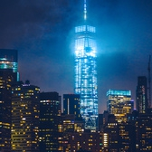 Turris Lucis | Standing on the edge of the East River in Brooklyn, I watched a storm pass over Manhattan. From here you could see One World Trade Center grazing the clouds as its glow illuminated the city sky.