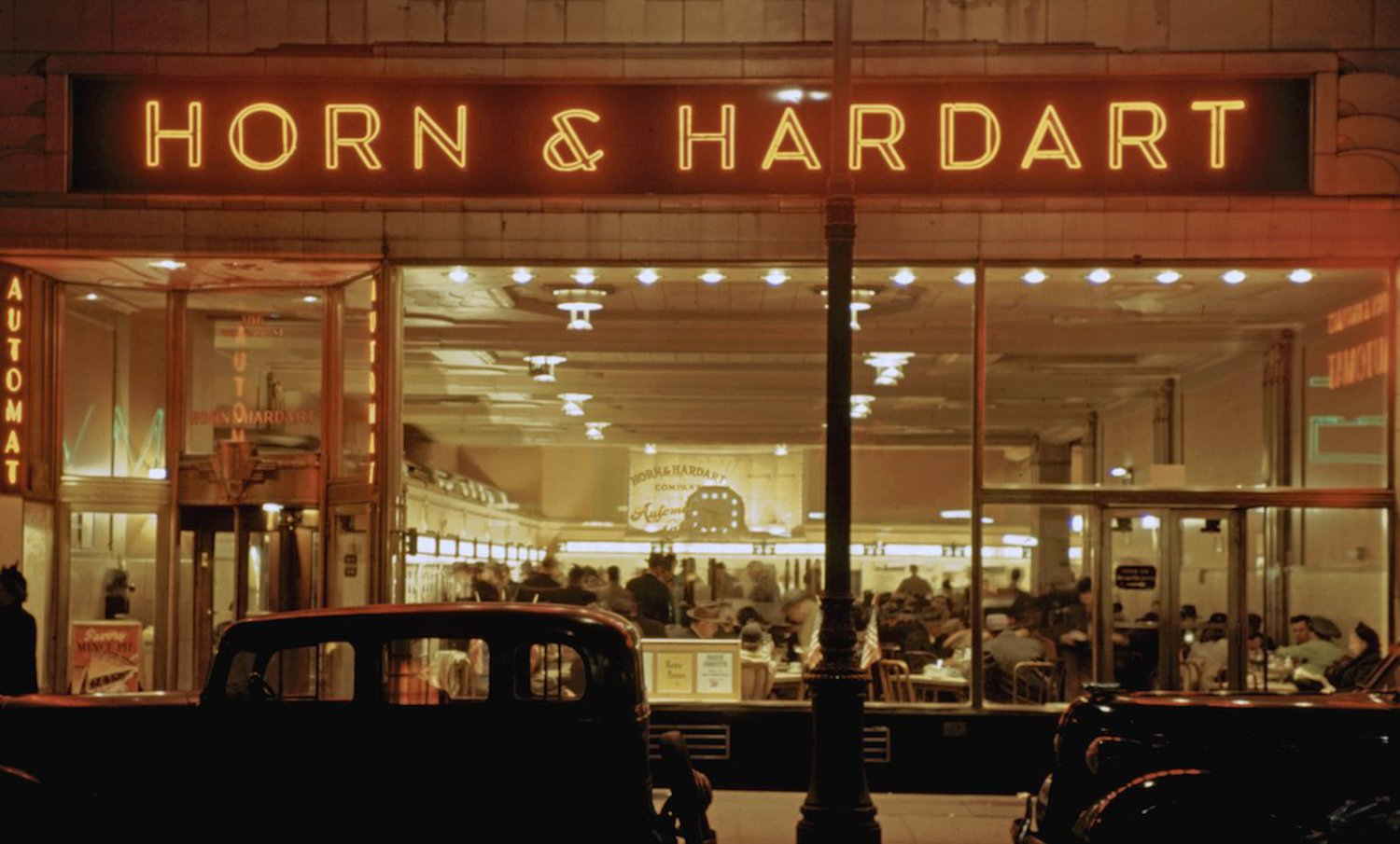 "1946 Patrons eating at the ""Horn and Hardart"" restaurant in the Times Square area at night."