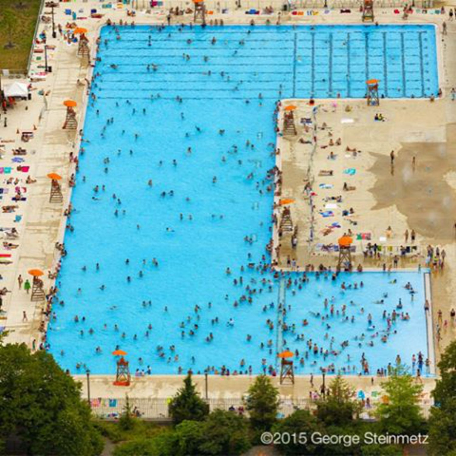 Photograph by George Steinmetz @geosteinmetz / @thephotosociety  McCarren Pool was the eighth of eleven giant pools built by the #WorksProgressAdministration and opened in 1936.  The city's first outdoor public swimming pools were attached to baths and dated from the turn of the twentieth century; before that, there were floating baths in the Hudson and East Rivers.