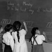 1940s — September 1943: First-grade pupils at the blackboard