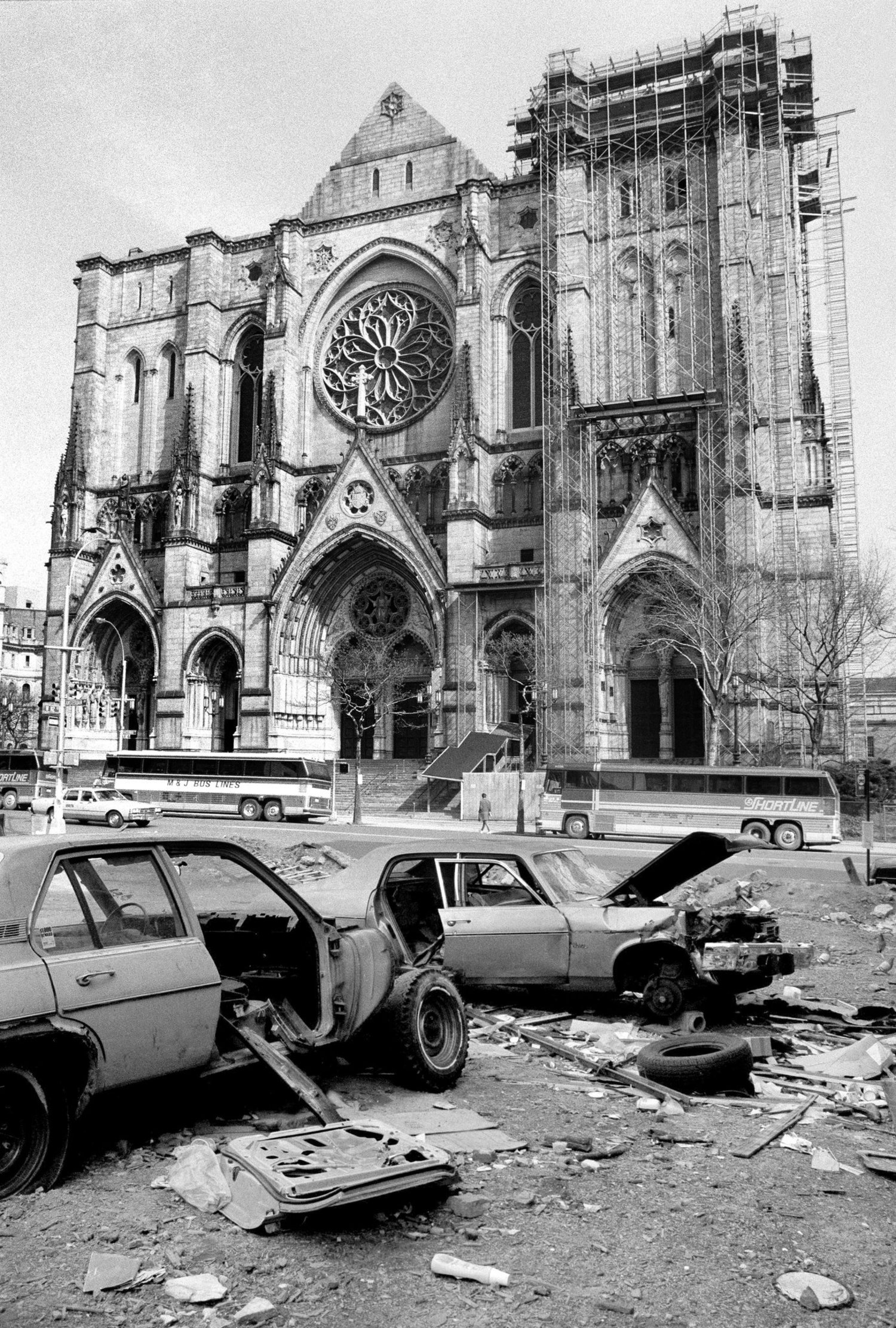 Abandoned cars littered Amsterdam Avenue and 112th Street, across the street from the Cathedral of St. John the Divine. April 10, 1985.