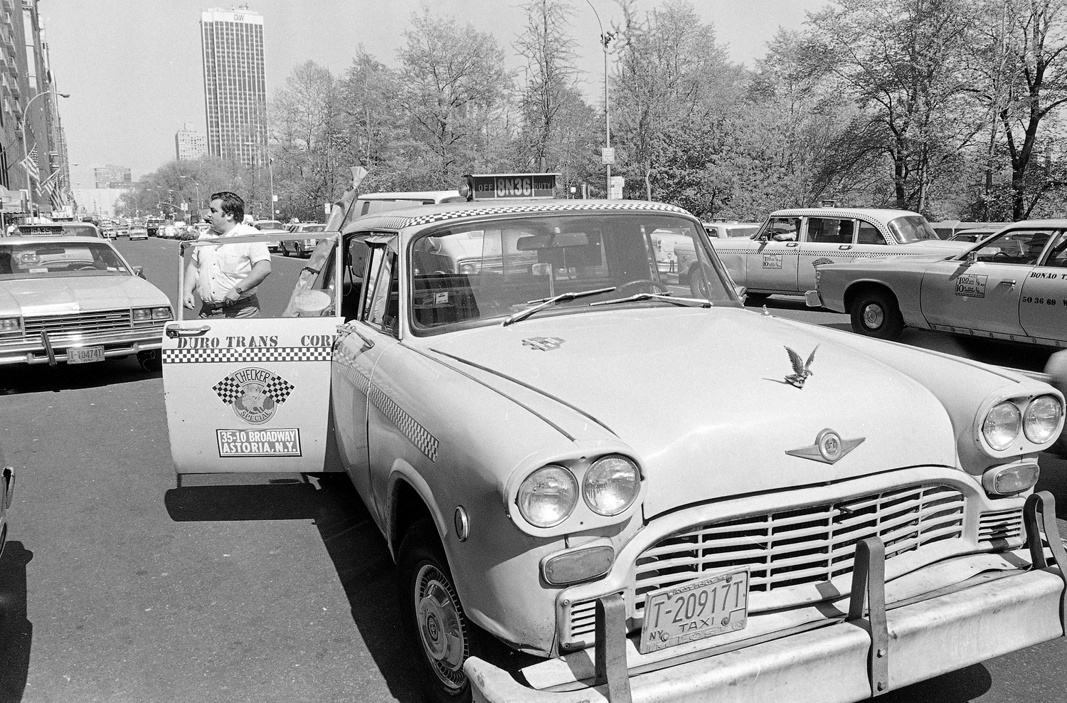 A checkered cab is pulled over on New York's Central Park South, May 4, 1982, right around the time that the Checkered Motor Co. announced it was going out of production.