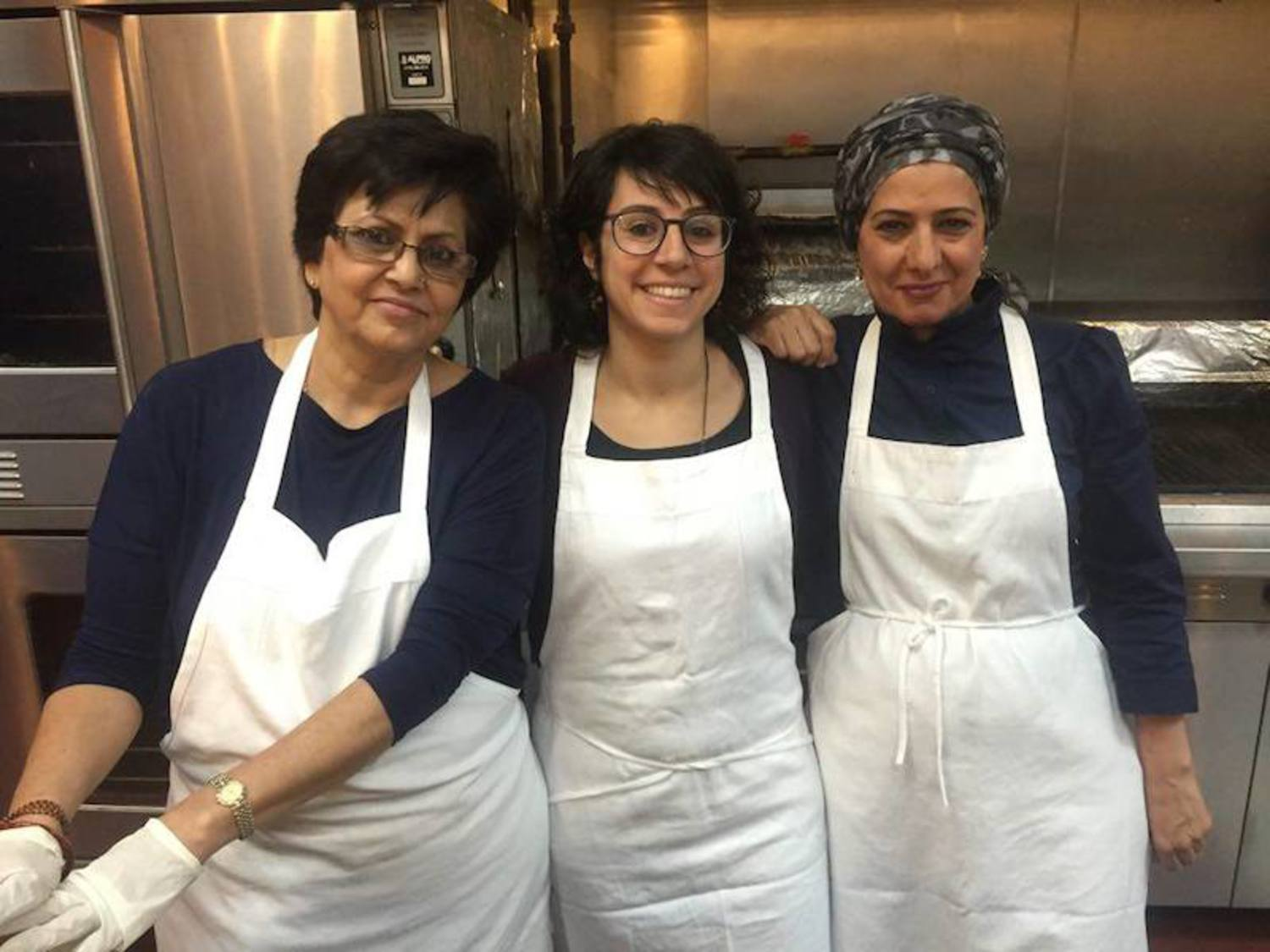 From left to right: chef Rachana Rimal, CEO Manal Kahi, and chef Nida Al Janabi in the kitchen
