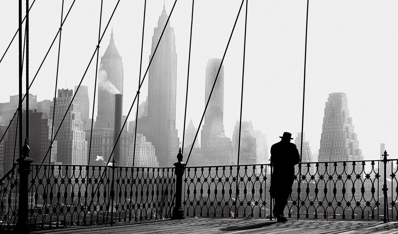 Man gazing off Brooklyn Bridge, 1950